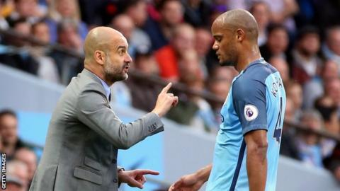 Manchester City manager Pep Guardiola and Vincent Kompany