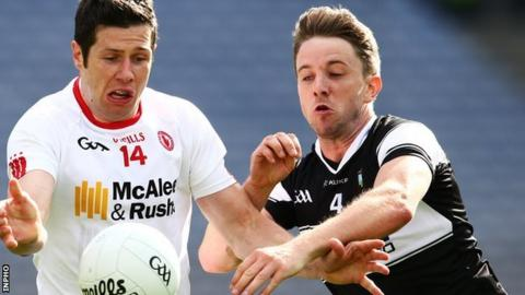 Tyrone's Sean Cavanagh battles with Sligo's Daniel Maye at Croke Park