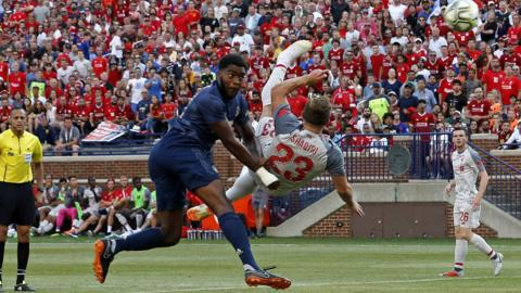 Michigan, United States, 28 July: Liverpool's Xherdan Shaqiri scores an overhead kick during the second half of the International Champions Cup football match against Manchester United at Michigan Stadium in Ann Arbor. (Photo by Jeff Kowalsky/AFP/Getty Images)