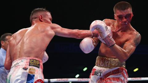 Josh Warrington lands a right shot on Lee Selby during IBF Featherweight Championship fight at Elland Road on May 19, 2018 in Leeds, England. (Photo by Alex Livesey/Getty Images)