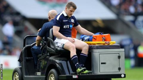 Mark Bennett leaves the pitch injured during the 2017 Six Nations match against England