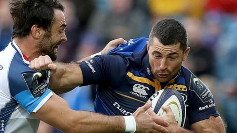 Leinster fullback Rob Kearney is tackled by Alex Robert Ebersohn