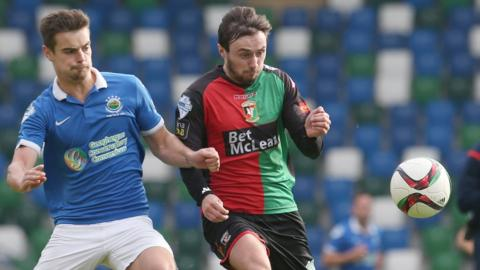 Linfield defender Matthew Clarke in action against Fra McCaffrey of Glentoran during the 1-1 draw at Windsor Park