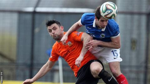 Glenavon's Eoin Bradley and Linfield's Sean Ward in action last season