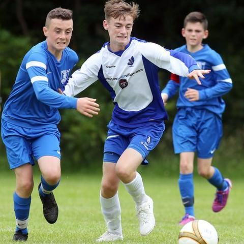 Waterford's Jack G Taylor and Aaron McClafferty of the Trojans in Under-13s action on the opening day of the 2015 Foyle Cup