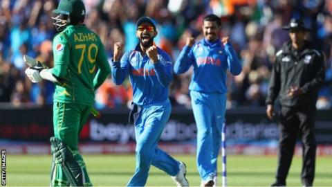 Virat Kohli (2L) of India celebrates as Ravindra Jadeja captures the wicket of Azhar Ali of Pakistan during the ICC Champions Trophy match between India and Pakistan at Edgbaston on June 4, 2017.