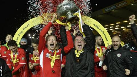 Cliftonville captain George McMullan and manager Tommy Breslin celebrate with the League Cup last season