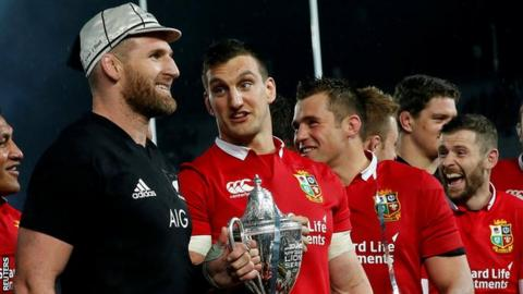 Kieran Read and half a dozen Lions pictured during the trophy presentation