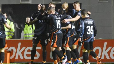 Obadeyi (left) is mobbed by his teammates after scoring Killie's winner