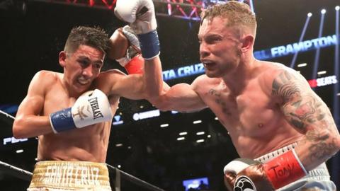 Leo Santa Cruz on the defensive as Carl Frampton lands a punch in the Belfast man's victory
