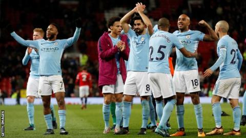 Manchester City players celebrate after their Derby win at Manchester United