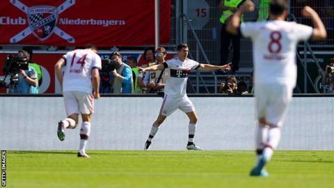 Bayern Munich's players celebrate scoring against Ingolstadt