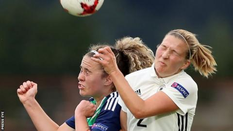 Brenna McPartlan of Northern Ireland competes with Germany's Dina Orschmann