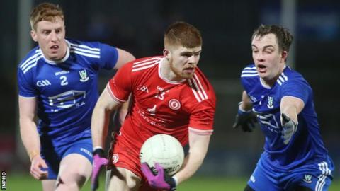 Tyrone's Cathal McShane attempts to get past Monaghan's Jack McCarron at Healy Park