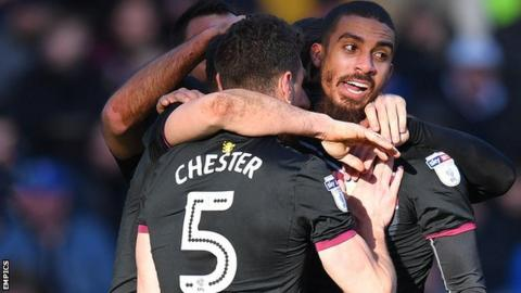 Aston Villa celebrate a goal by Lewis Grabban (right)