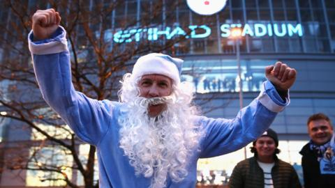 Man City fan dressed as Santa
