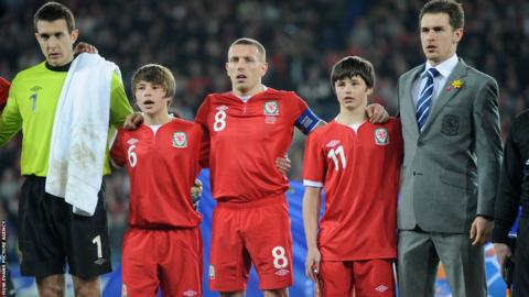 Gary Speed's sons Ed and Tommy led the tributes ahead of Wales' game against Costa Rica in February 2012 in Cardiff.