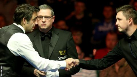 Ronnie O'Sullivan and Kyren Wilson shake hands before their encounter in Belfast on Wednesday