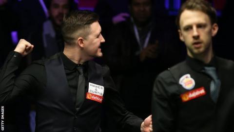 Kyren Wilson (left) celebrates victory over Judd Trump in last season's Masters semi-finals