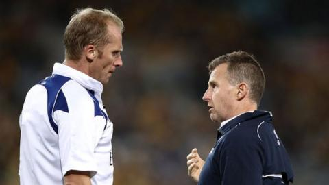 Wayne Barnes and Nigel Owens discuss a refereeing decision during a match