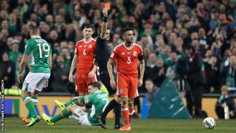 Wales left-back Neil Taylor was sent off for his tackle that broke Seamus Coleman's leg in Dublin