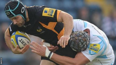 Chris Bell is tackled by Worcester full-back Chris Pennell