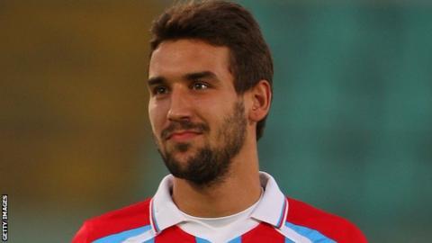 Blazej Augustyn playing for Catania in 2011