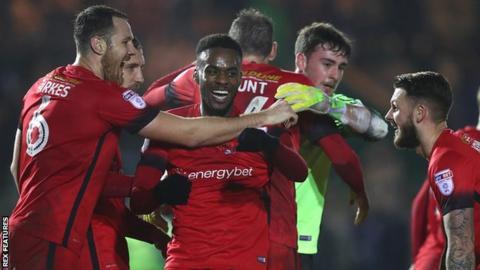 Leyton Orient players celebrate their win over Plymouth Argyle