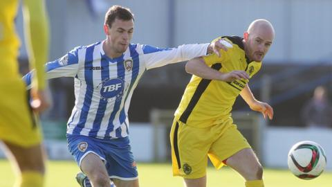 Coleraine's Darren McCauley challenges Cliftonville midfielder Ryan Catney as the sides draw 0-0 on Saturday