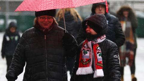 Fans walk outside the stadium