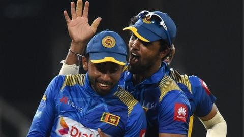 Sri Lanka captain Dinesh Chandimal celebrates with team-mate Sadeera Samarawickrama (left)