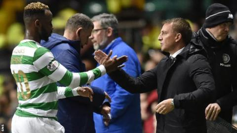 Moussa Dembele shakes hands with Brendan Rodgers