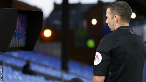 Referee Michael Oliver reviewing an incident on the pitchside monitor during Crystal Palace's FA Cup tie against Derby