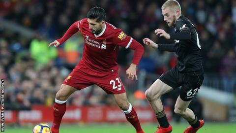 Swansea's Oli McBurnie tussles with Emre Can of Liverpool