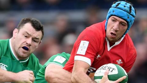 Justin Tipuric is tackled in Dublin
