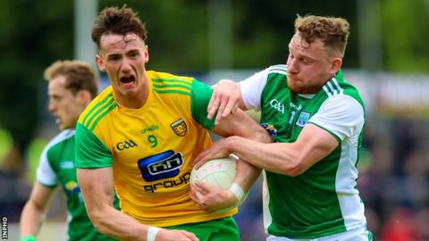 Donegal's Jason McGee is challenged by Fermanagh's Aidan Breen at Brewster Park