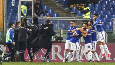 Sampdoria's players celebrate scoring at Roma