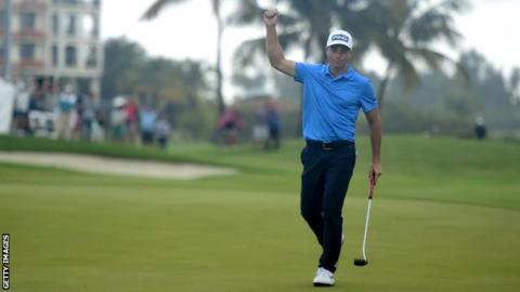 Viktor Hovland punches the air in celebration after hitting a birdie putt on the final hole to win the Puerto Rico Open trophy