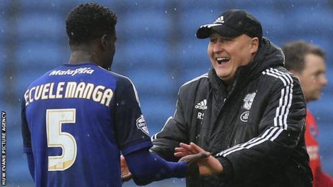 Cardiff City manager Russell Slade greets defender Bruno Ecuela Manga