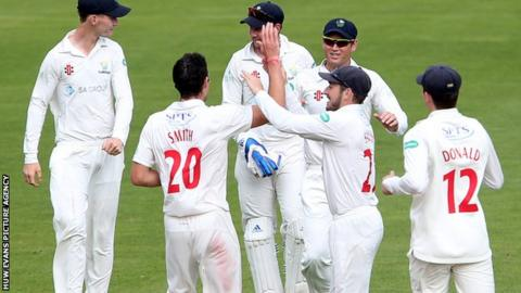 Glamorgan celebrate the one Gloucestershire wicket to fall on day two