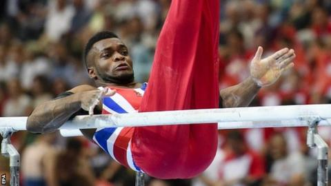 Courtney Tulloch from Britain performs on the parallel bars