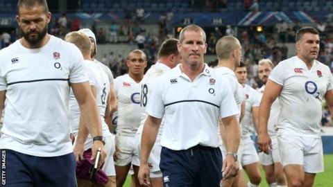 England head coach Stuart Lancaster (centre) leads his team off the field after defeat in Paris
