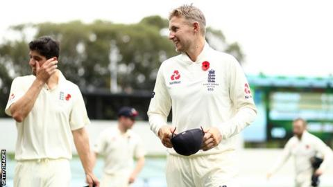 Alastair Cook and Joe Root celebrate a winning start for England during their Ashes Tour as they leave the Adelaide Oval pitch