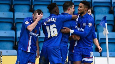 Gillingham's players celebrate John Egan's winner against Bury