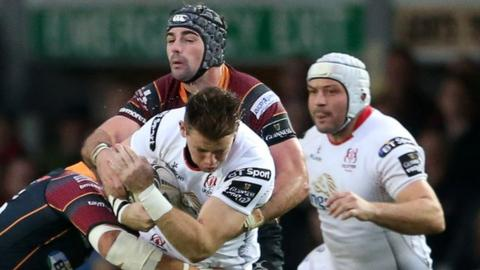 Craig Gilroy attempts to go on a charge for Ulster with Rory Best in close attendance