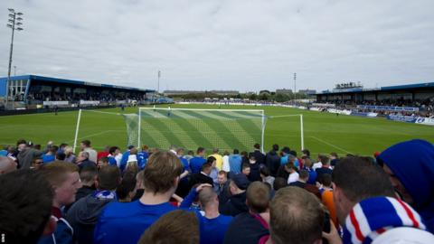 Almost 4,500 fans pack in to Peterhead's Balmoor Stadium to watch Rangers' first match in the Third Division