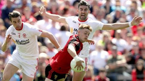 Down's Jerome Johnston in action against Conal McCann and Tiernan McCann in last year's Ulster Football final