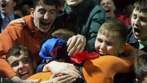 Dundee United's Pavol Safranko gives his shirt to a fan at full time