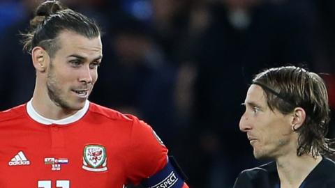 Gareth Bale and Luka Modric talk to each other during Wales v Croatia