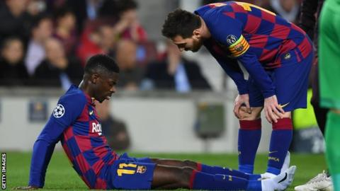 Barcelona winger Ousmane Dembele (left) is consoled by Lionel Messi (right) after injuring his thigh against Borussia Dortmund